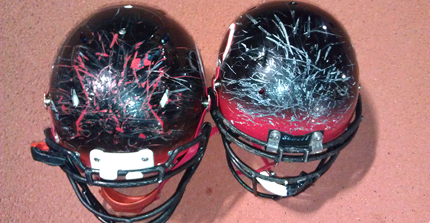 Helmets showing force of impact.